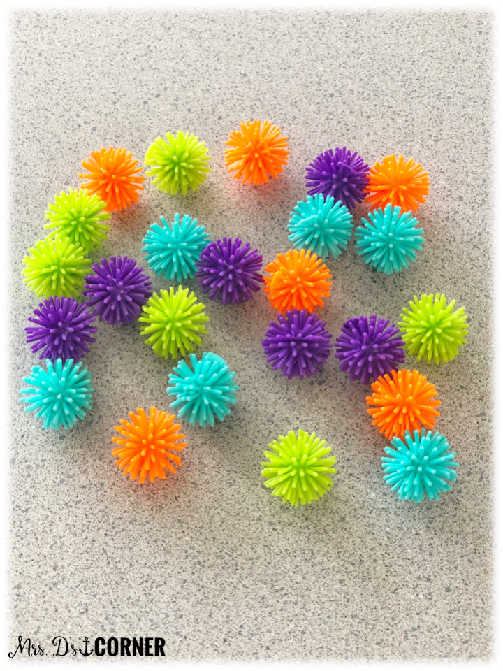 Plastic spike balls work best, but you can use pom balls too.