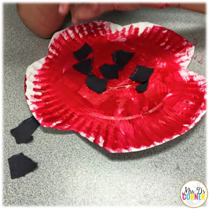 poppy craft - then glue the ripped up black paper onto the center